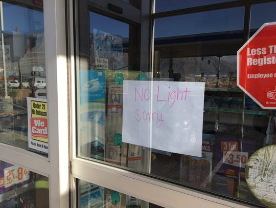 """A gas station has a sign that reads """"No Light Sorry."""""""
