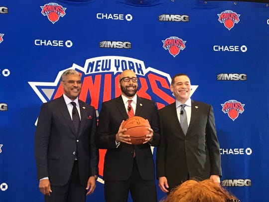 David Fizdale poses for pictures with Scott Perry and Steve Mills after being introduced as Knicks head coach.