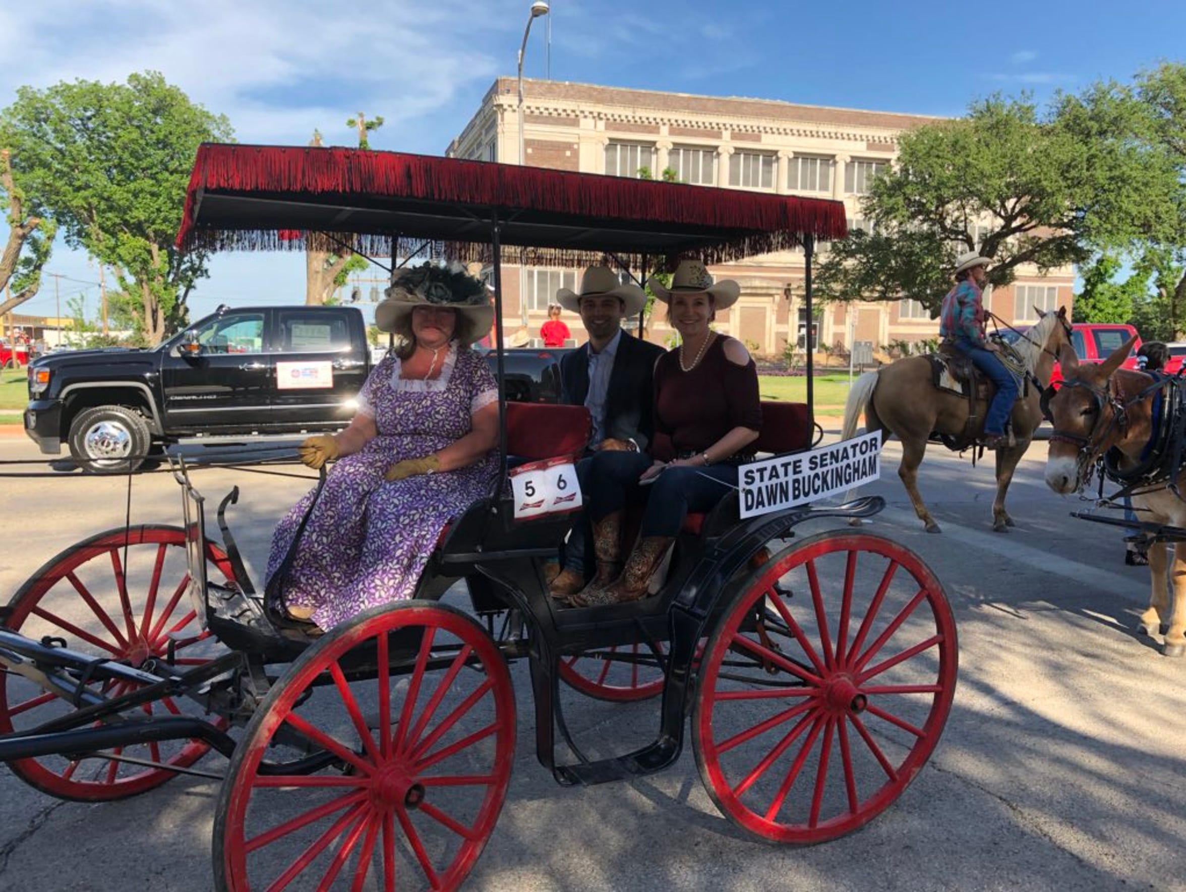 State Sen. Dawn Buckingham, right, Adrian Piloto, center, and driver Evadean Owen wait for the start of the Western Heritage Classic Parade on May 10.  Motorcycle noise later caused their horse to bolt, overturning the buggy and injuring the driver.