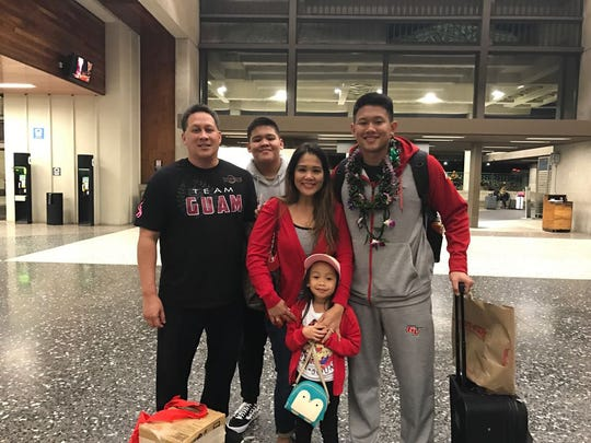 College volleyball player Eric Ada at far right with hsi family at the airport. They are from left, his father Herman, his brother Kyle, his mom Kat and sister Kyla.