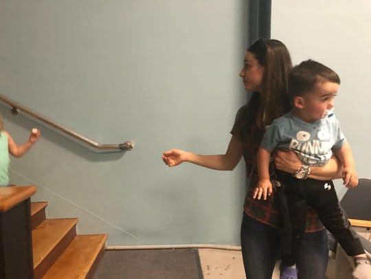 Millbrook resident Jessica Weglinski carries her son,