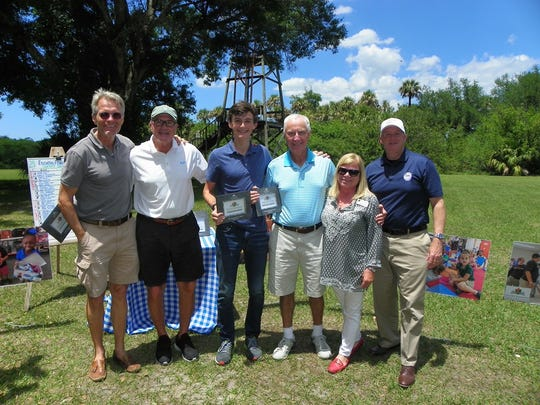 Windsor Gun Club Director Nicky Szapary, left, with second place winners Ric Zimmerman, Ivor Zimmerman, and Alastair Kennedy, along with Education Foundation Board President Cathy Filusch and Schools Superintendent Dr. Mark Rendell.