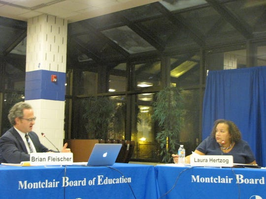 Then-Montclair School District Business Administrator Brian Fleischer speaks with Montclair Board of Education member Laura Hertzog during the Montclair Board of Education budget workshop in 2016 in the George Inness Annex Atrium.