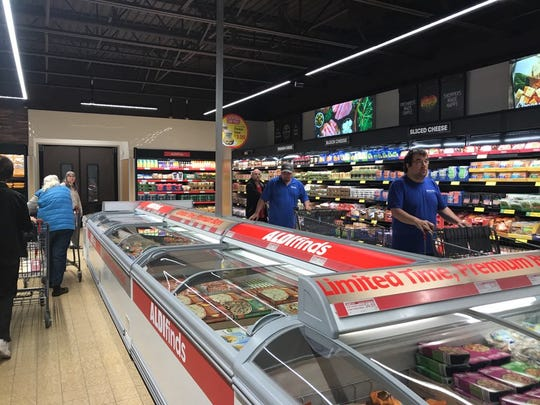 Customers browse for groceries at Aldi in Rib Mountain on opening day.
