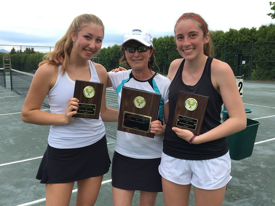 CVU's Kendall Blanck and Renee Dauerman pose with their coach, Amy deGroot, middle, after winning the girls doubles title at Burlington Tennis Club last year.