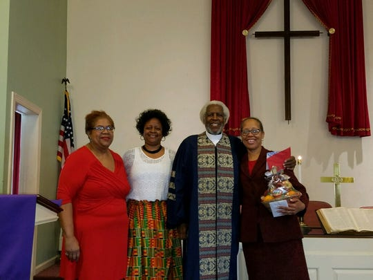 Allie Harper Jr. (right center) poses for a photo with his wife, Renata Moseley Harper (right) and two members of John Wesley A.M.E Zion Church's congregation, Jamia Wright (left center) and Theda Davis (left). Allie Harper worked as the Chambersburg church's pastor for 10 years until his passing on Tuesday, April 24.