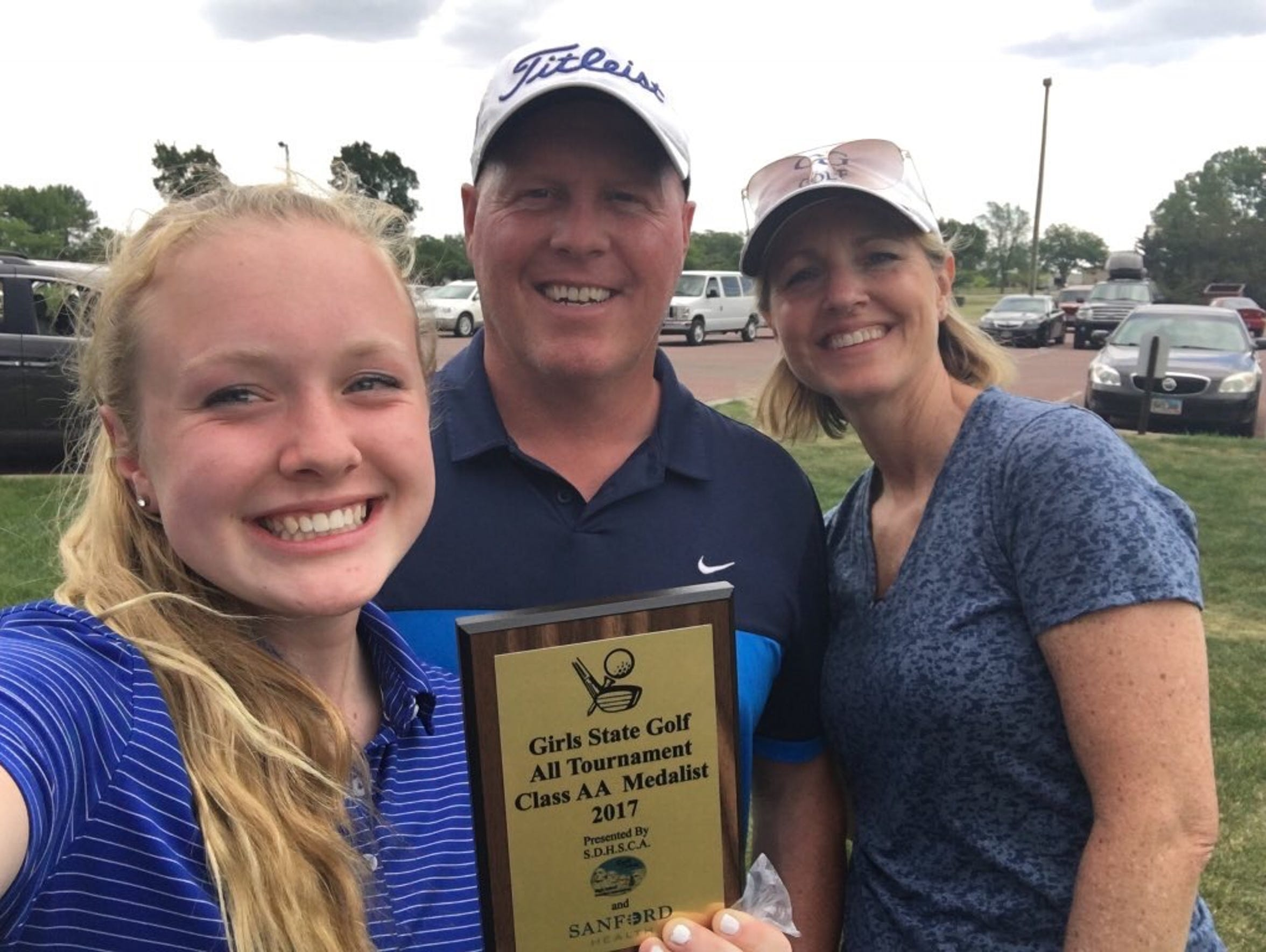 O'Gorman golfer Carly Kunkel (left) poses for photo