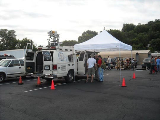 Tailgaters set up at a previous Hamfest and Electronics Exhibition.
