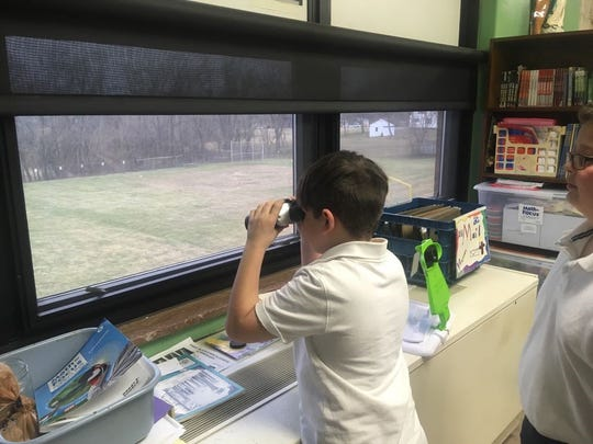 Bishop Flaget fourth-grader David Warner observes bird activity from his classroom window during the recently completed school year.