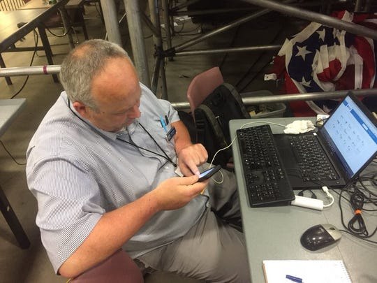 This is a picture of me taken by colleague Karl Puckett. I'mTweeting at July 5 Trump rally in Great Falls. I wish Karl would use his powers to find good parking rather than take photos of me.