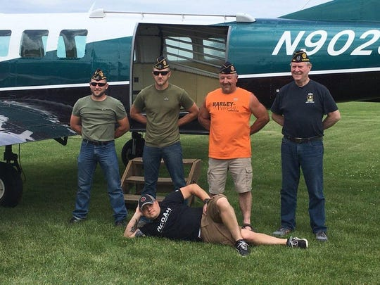 """Five military veterans and one active duty soldier from Suring participated in a skydiving experience last month. The veterans, from left, are Zach School, Earl School, Rich School (all Marine Corps), and Doug Klismet (Army). Not pictured was Eric Berg (Marines). In front is Steve Westphal, who is still in the service. All are members of Harold C. Anderson American Legion Post 283, Suring. The trip was coordinated by Westphal, who is vice president of the """"4th Helping Out Our American Heroes"""" (HOOAH), which pays for the annual outing. The parachuting service was provided by Seven Hills Skydivers, Madison."""