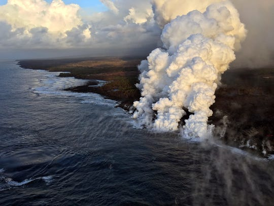 Plumes rise where lava pours into the sea from Kilauea volcano on the Big Island of Hawaii last month. The eruption has destroyed more than 700 homes. It's just one of many natural disasters grabbing Americans' attention this summer.