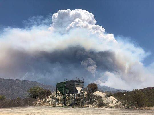 This file photo shows the Ribbon Fire off Highway 74, near Pinyon Pines. The 205-acre blaze was sparked by lightning, officials say.