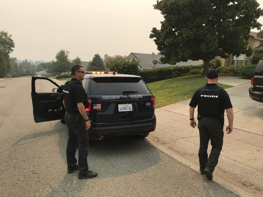 Redding police officers were exceptionally busy in July 2018, looking for possible looters as a result of the massive Carr Fire. Officers are shown patrolling the Mary Lake neighborhood.