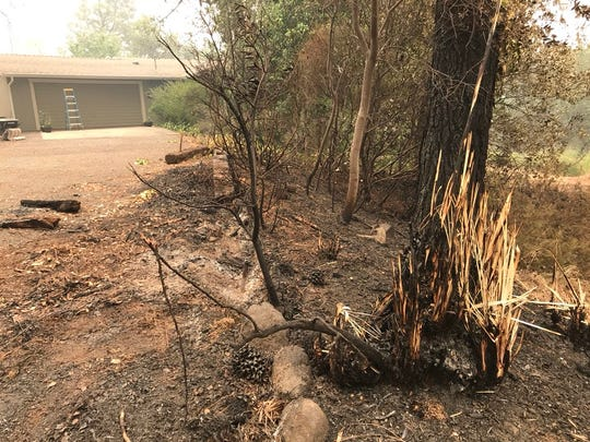 In addition to the hundreds of homes lost in the Carr Fire, firefighters were able to save residences too, like this one on Blarney Road where the vegetation burned outside