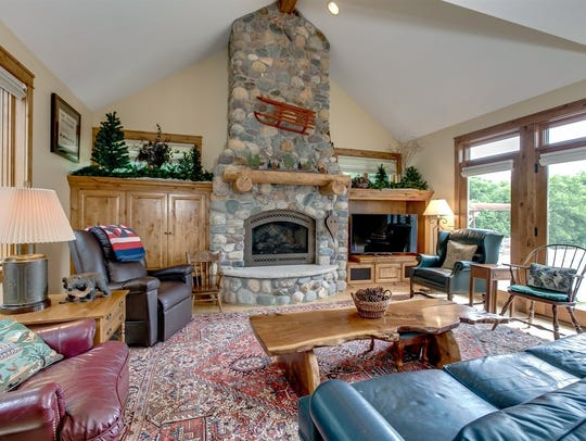 The stone fireplace at the far end of the living room