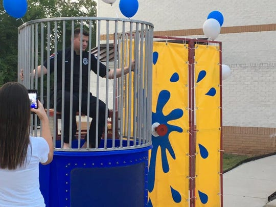 "Apartment complexes that wish to be certified in the Murfreesboro Crime Free Multi-housing Program must host a ""safety social"" event to create a community watch. Officer Jacob Lamb, a community engagement officer with the program, sits in a dunk tank at Murfreesboro's first safety social."