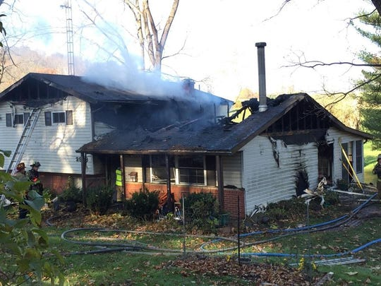 A fire damaged a home at 2982 Opossum Hollow Road NE in Newark Township.