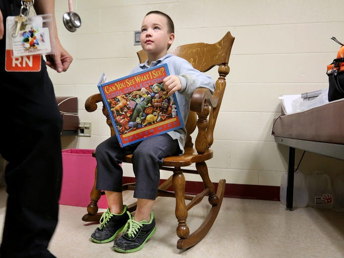 Arthur Murray, 8, talks to Nurse Barb Demasi at Taylor