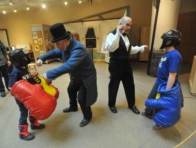 Madison Burnett, 8, left, and Nolan Burnett, 11, both of Indianapolis, get some lessons in boxing from presidents Martin Van Buren, left, portrayed by MikeSchoening of Noblesville, and Andrew Jackson, portrayed by  Dwight Gallian of Carmel, in the Create.Connect area at the Presidents Day celebration at Conner Prairie Interactive History Park, Monday February 17, 2014.