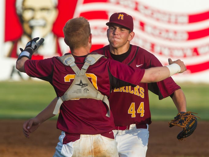 McCutcheon pitcher Jordan Young, 44, and catcher Tyson Scheumann celebrate their 2-0 win over Logansport in the sectional final Monday, June 2, 2014, at Loeb Stadium in Lafayette. McCutcheon won 2-0 to advance to the regional bracket.