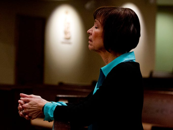 "Bertica Garcia Dubus, an East Valley Catholic and Catholic school art teacher, prays at St. Timothy in Mesa on 3/25/14. Bertica says,"" Prayer is important to me because it is like breathing; it's something that I can not live without."""