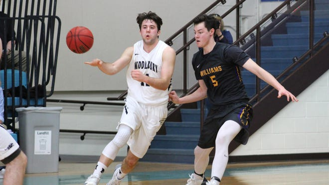 """Middlebury guard Matt St. Amour, a senior, passes the ball in Sunday's game against Williams. He was a two-time Free Press """"Mr. Basketball"""" award winner while at Missisquoi Valley Union High School."""