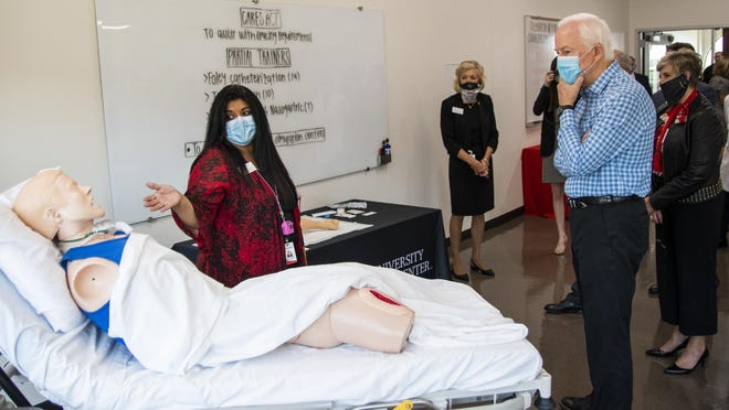 Texas Senator John Cornyn tours the Texas Tech Health Science Center to see how CARES Act funding is being used to research and combat COVID-19 on Tuesday, Aug. 18, 2020, in Lubbock, Texas.