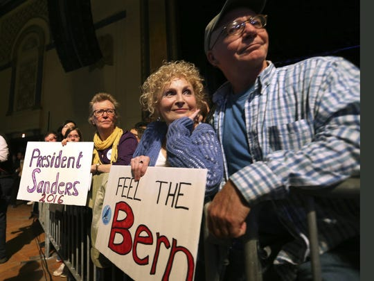 Supporters hold signs while as listen to Democratic presidential candidate, Sen. Bernie Sanders, I-Vt. speak at a campaign rally, Monday, May 9, 2016, in Atlantic City, N.J. (AP Photo/Mel Evans)