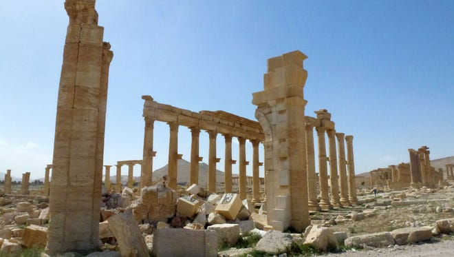 This file photo taken on March 27, 2016 shows a view of the remains of Arch of Triumph, also called the Monumental Arch of Palmyra, that was destroyed by Islamic State (IS) group jihadists in October 2015 in the ancient Syrian city of Palmyra.
