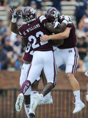 Mississippi State's Aeris Williams (22) and Mississippi State's Nick Fitzgerald (7) celebrate after Mississippi State's Fitzgerald (7) scored on a run to give MSU a 7-0 lead. Mississippi State played Charleston Southern in a college football game on Saturday, September 2, 2017 at Davis Wade Stadium in Starkville.