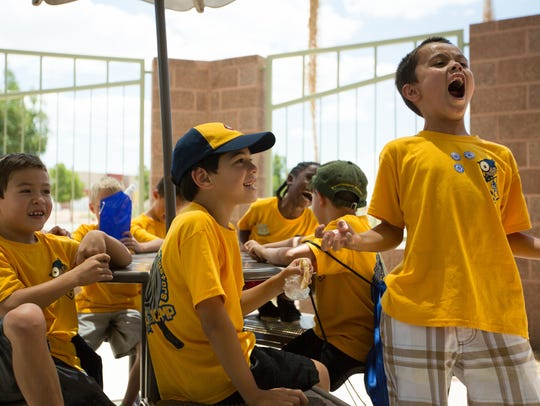 The Wolves and Tigers Cub Scouts practice their skit