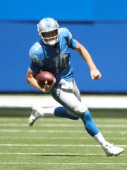 Lions quarterback Jake Rudock runs for a first down during the second quarter of the Lions' 24-10 exhibition win over the Colts on Sunday, Aug. 13, 2017, in Indianapolis.