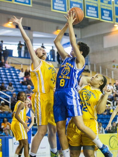 Blue team's Alison Lewis (No. 8), of Sanford, puts up a shot in the first half of the Blue-Gold Girls All-Star Basketball Game at the Bob Carpenter Center in Newark on Saturday afternoon, March 15, 2014. The Blue team defeated the Gold by a score of 106-83.