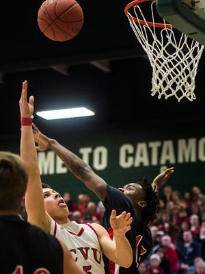 CVU's #5 Graham Walker gets a shot over Rutland's #15 Tyrell Johnson during the Vermont state boys high school championship at Patrick Gymnasium in Burlington on Monday night, March 13, 2017. Rutland won for the first time in 50 years, 43-37 after a tie forced the game into overtime.