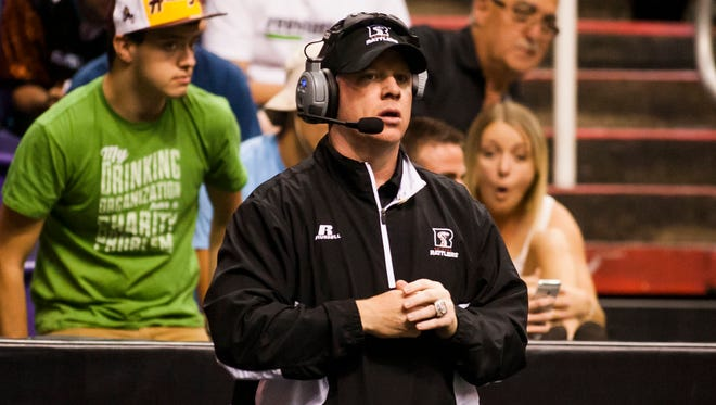 Head Coach Kevin Guy watches the Jacksonville Sharks and Arizona Rattlers arena football game on Saturday, April 5, 2014 in Phoenix, Arizona.