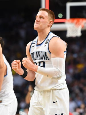 Villanova Wildcats guard Donte DiVincenzo (10), a Salesianum School graduate, celebrates after defeating the Michigan Wolverines 79-62 in the championship game of the 2018 men's Final Four at Alamodome.