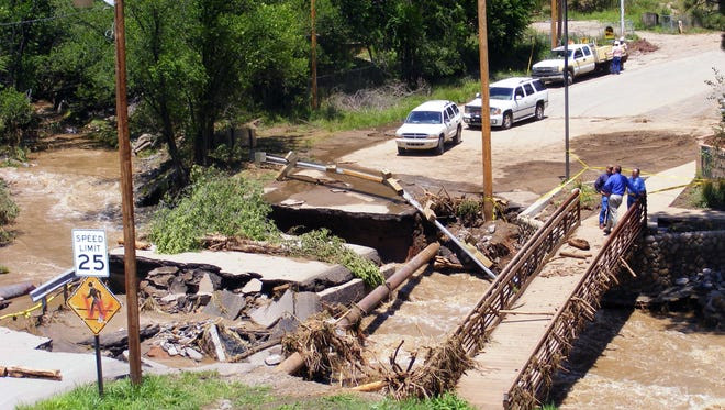 The bridge and road across the Rio Ruidoso at Eagle Drive was one of 13 bridges destroyed or damaged in 2008. It is the only one replaced with a span-type design to withstand future flooding. Close Bridge is next on the list.