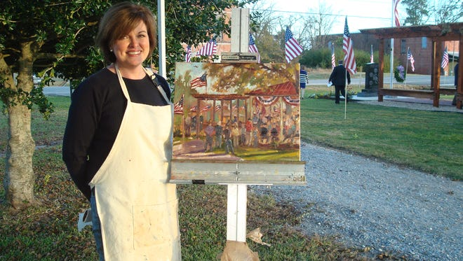 Artist Barbara Davis discusses her plein air painting with Town of Pike Road Mayor Gordon Stone. The painting captures the town's 2012 Veterans Day program. Artists from across the state and Southeast will gather in Pike Road in October to paint outdoors.