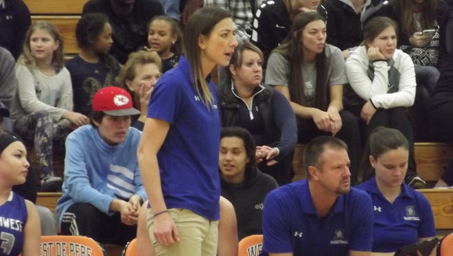 Green Bay Southwest girls basketball coach Erin Barkley yells instructions to her team during a nonconference game at West De Pere on Friday. Barkley is in her first season as a varsity head coach.