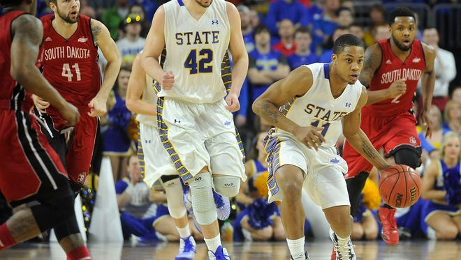 File photo: SDSU's #11 George Marshall drives the basketball down the court against USD during the Summit League Tournament semifinal game on Monday, March 9, 2015, at the Denny Sanford Premier Center in Sioux Falls, S.D.