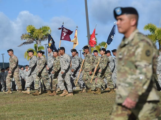 In this March 4 file photo, soldiers and airmen march during the Guam National Guard Retreat Ceremony at the Guard's Readiness Center in Barrigada.