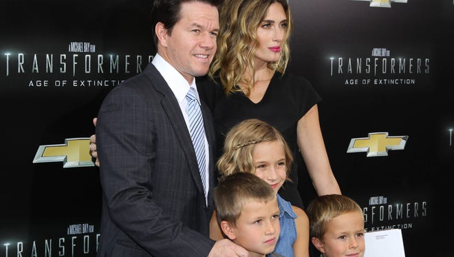 """Mark Wahlberg with wife Rhea Durham and family attend """"Transformers: Age Of Extinction"""" New York Premiere at Ziegfeld Theater on June 25, 2014 in New York City."""