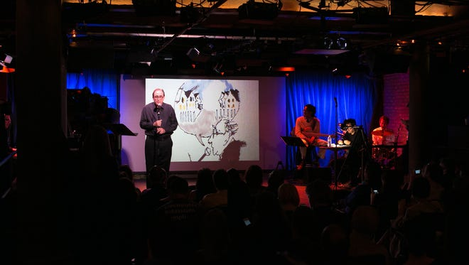 Author R.L. Stine (@RL_Stine) tells a ghost story while artist Michael Arthur (@inklines, right) illustrates the story live on stage at #TwitterFiction Festival Live!