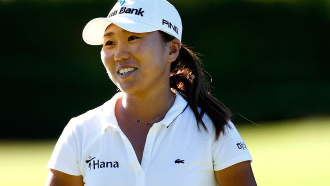 I.K. Kim of South Korea smiles after making birdie put on the 11th hole during the first round of the LPGA Portland Classic at the Columbia Edgewater Country Club on August 28, 2014 in Portland, Oregon.