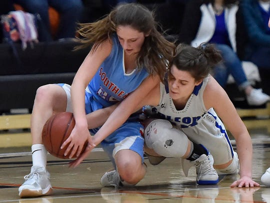Southern Door's Kendra Dantoin battles for a loose ball with an Amherst defender Saturday at Kaukauna.