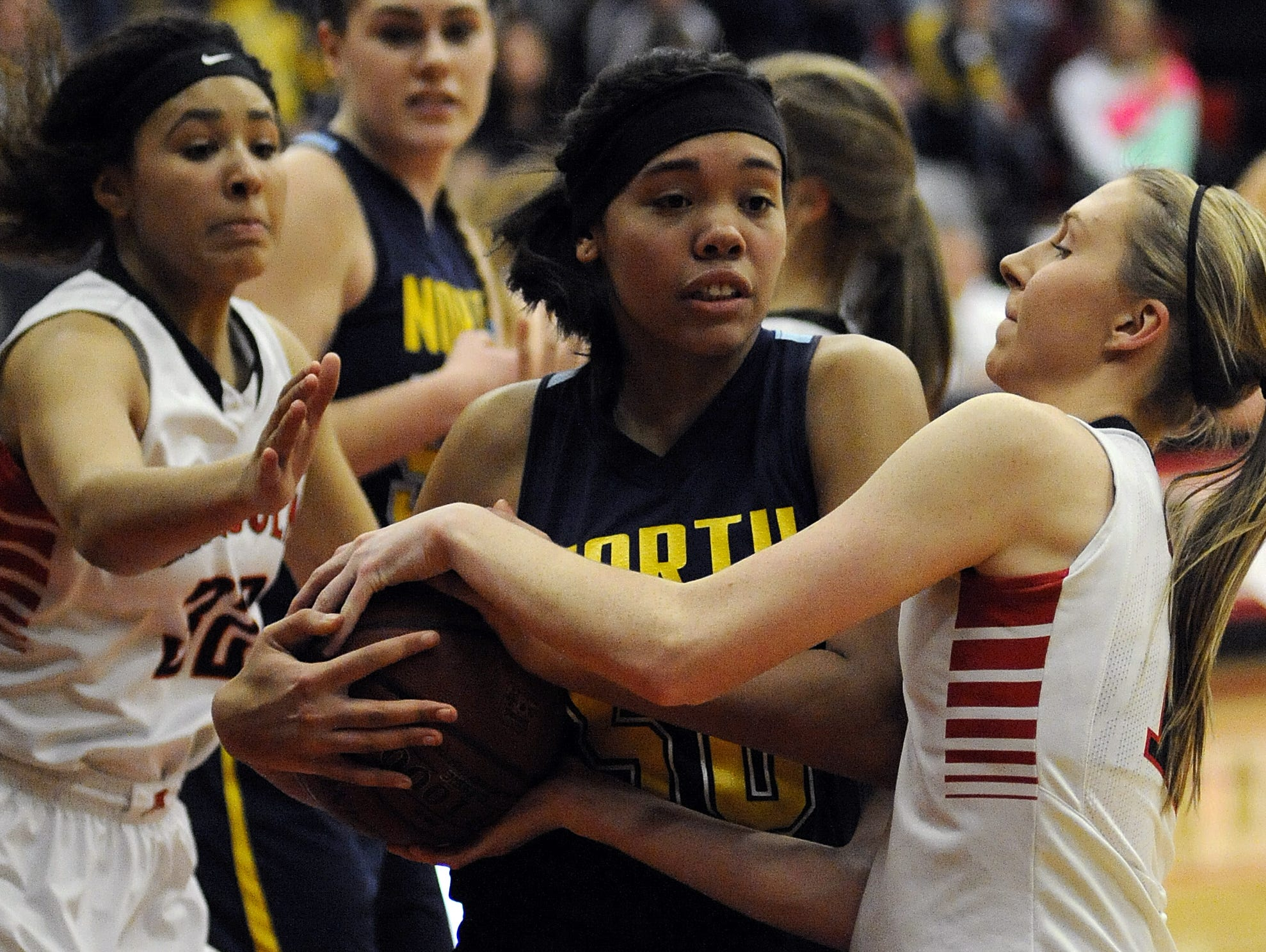 Junior center Kiara Dallmann, center, will be counted on to take on a bigger role with the Golden Raiders this year.