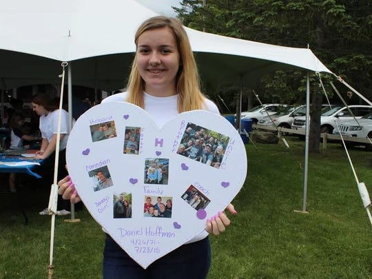 Doria Hoffman with the heart collage she made in memory of her father, Daniel.