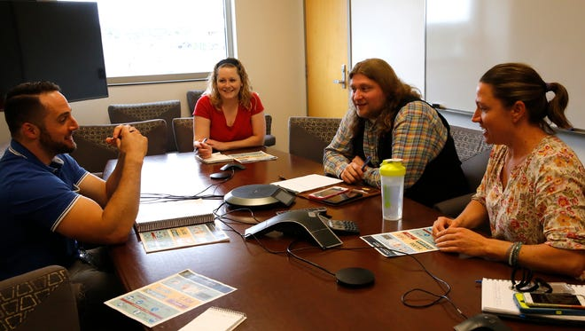 BLM officials talk earlier this month about the BLM permitting process at their Farmington office. From left, Michael Porter, natural resource specialist; Katie White Bull, planning and environmental coordinator; Zach Stone, BLM spokesman; and Sarah Scott, supervisory natural resource specialist.