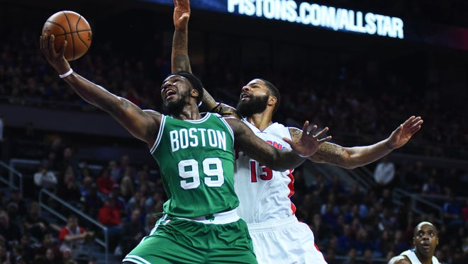 Celtics forward Jae Crowder (99) goes to the basket as Pistons forward Marcus Morris (13) defends during the second quarter at The Palace of Auburn Hills Saturday.